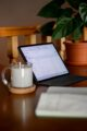 ipad pro on desk with notebook and tea